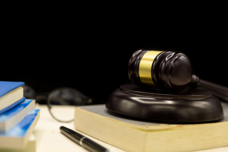 judges gavel on book and wooden table law and justice concept background Porteo