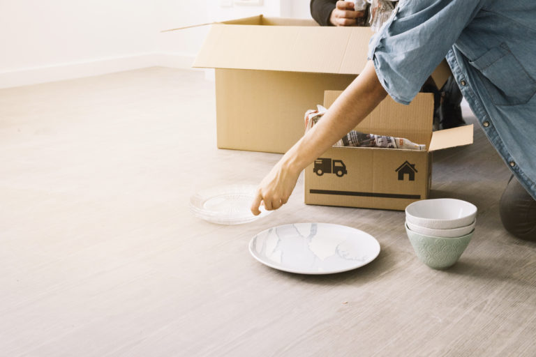 moving concept with woman and boxes Porteo